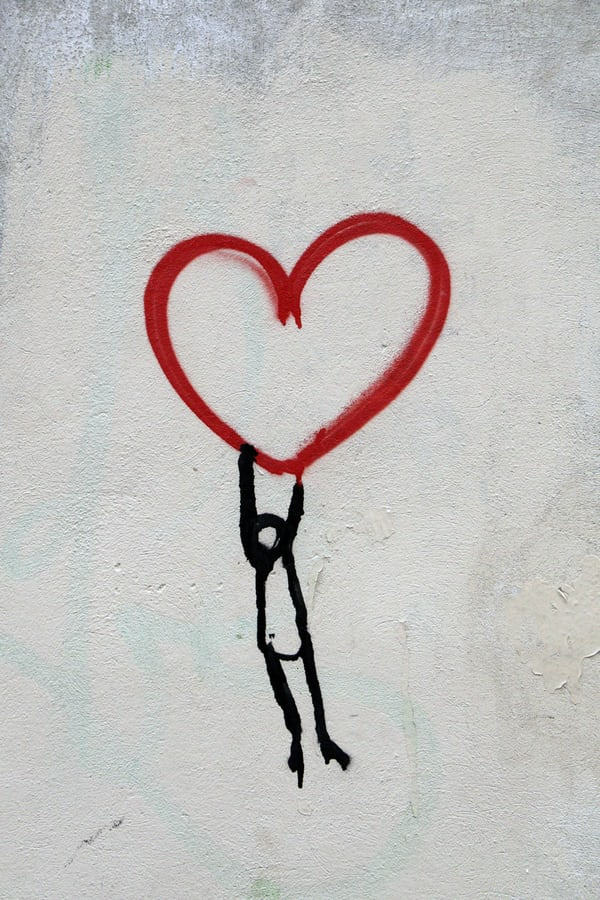 drawing of heart with stick man hanging